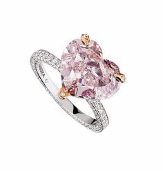 Diamond Engagement Rings Messika Heart pink diamond engagement ring with rose gold prongs and a diamond pavé band. - Dwindling supplies from the Argyle Mine in Australia make pink diamond engagement rings an extremely rare, expensive and desirable choice. Pink Diamond Engagement Ring, Heart Engagement Rings, Pink Diamond Ring, Engagement Ring Shapes, Diamond Bands, Diamond Jewelry, Pink Diamonds, Champagne Diamond, Pink Champagne