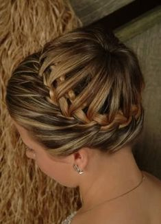 A creative,stylish bun with French braids.This bun hairstyle for prospective brides