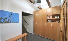 Custom built Fir LDL cabinets & bench for front entrance storage   Lorenz Developments Ltd.