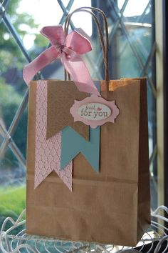 DIY Decorated Gift bags ~ Cute way to reuse shopping bags.just cover the logo with more paper then add cute accents Paper Gift Bags, Paper Gifts, Diy Paper, Paper Bag Gift Wrapping, Wrapping Presents, Creative Gift Wrapping, Creative Gifts, Pretty Packaging, Gift Packaging