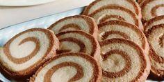 cookie biscoito bicolor bolachinha espiral bolacha . 3 1/2 xícaras de farinha de trigo . 1/2 xícara de fécula de batata . 3/4 de xícara de açúcar . 1 pitada de sal . 1 1/4 xícara de manteiga em temperatura ambiente . 1 colher (chá) de açúcar vanille . 2 colheres (sopa) de chocolate em pó . 1 clara de ovo ligeiramente batida