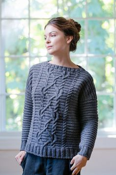 Corrugated texture provides a trellis for twining cables at the center front and back. Hague sports a boxy silhouette with a bateau neck and exaggerated drop shoulders that create a chevron detail where the welts meet at the seam line. This pullover is a quick knit in chunky Quarry, and the bold texture of this …