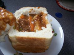 """Bunny Chow: """"...during the Great Depression Indians, whites & Chinese in Durban suffered hunger... The cheapest curry was made by an Indian caste known in Durban slang as the Bania. Kids took to hollowing out a 1/4 loaf & getting the seller to put the curry into it. They then used the bread they'd taken out as an eating utensil. Chinese food was called """"chow""""... the two words came together: Bania Chow... With time it became simply, Bunny Chow."""" #cooking #recipes #food #southafrica #bunnychow"""