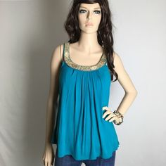 Beautiful Blue Wood Beaded Tank Top  Pre-owned in great condition. Soft stretchy fabric. Adorned with wood like beads. Perfect for summer. I have a bundle discount and hundreds of lovely listings in all different sizes! NO OFFERS PLEASE. Price is final unless bundled.  Charlotte Russe Tops