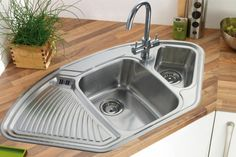 Corner sinks: advantages and disadvantages, shapes and sizes