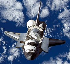 Backdropped by a blue and white Earth, Space Shuttle Discovery approaches the International Space Station during the STS-120 mission. The photograph was taken by astronauts aboard the ISS. The photograph was taken by astronauts aboard the ISS. The photograph was taken by astronauts aboard the ISS. The photograph was taken by astronauts aboard the ISS. The photograph was taken by astronauts aboard the ISS.