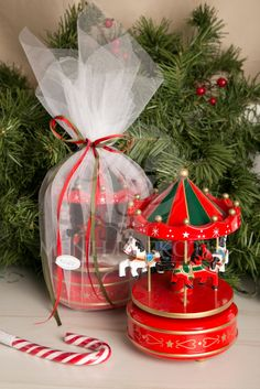 Christmas music carousel baptism favor. #christmasmusiccarousel #christmasgifts #christmasbaptism Christmas Favors, Winter Christmas, Xmas, Christmas Ideas, Christening, Snow Globes, Diy And Crafts, Baptism Ideas, Table Decorations