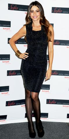 Vergara celebrated her latest collection for Kmart in the label's sparkling sheath, gold danglers, a statement bracelet and suede platforms.