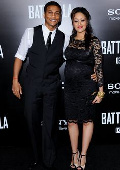 "The Hollywood couple looked nothing short of amazing at the Battle: Los Angeles premiere. It was clear that Cory's idea of ""casual-chic"" had drastically changed. Instead of a baggy jeans ensemble, the father-to-be opted for a black suit where he switched out the jacket for a vest. He also rolled up the sleeves on his white collared shirt. Tia was a style icon for pregnant women everywhere with her form-fitting lace black dress, T-strap nude-and-black heels and gold jewelry."