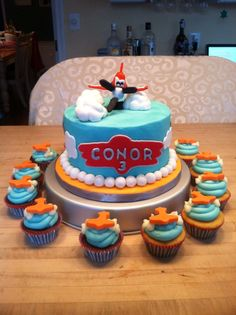 Planes cake and cupcakes.  (Change the name tag...something closer to the actual logo.)