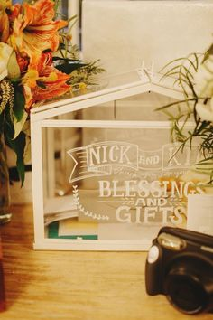 This mini glass greenhouse makes a cute place to post cards and blessings.   Personalise it with chalk pens or mini bunting. £12, IKEA Image: Pinterest