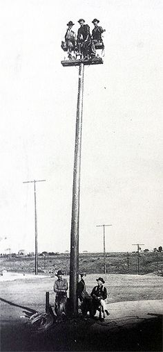 """Sitting on top of their work are linemen extending #SDGE's electric system to the """"rural"""" areas of North Park and east San Diego in 1904."""