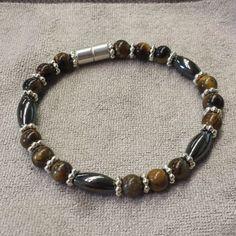 Beautiful Handmade Hematite Bracelet. Hematite Rice Beads, Tiger Eye Gemstone Rounds, and Strong Magnetic Clasp.