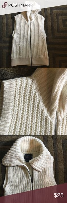 Sweater vest Creamy white chunky knit sweater zip. Two front pockets. Perfect for fall campus wear. Goes well with pumpkin anything lol Like new condition. American Eagle Outfitters Jackets & Coats Vests