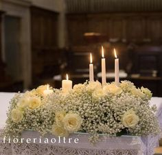 Fioreria Oltre/ Wedding ceremony/ Altar decoration/ Church wedding flowers/ White roses and baby's breath, candles   https://it.pinterest.com/fioreriaoltre/fioreria-oltre-wedding-ceremonies/