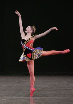 "Megan Fairchild in Peter Martins' Jeu de Cartes. New York City Ballet, October 2013. © Paul Kolnik. ""Jeu de Cartes,"" is entertaining, but, except for the colorful costumes for the principals and the strikingly simple costumes for the corps, it..."