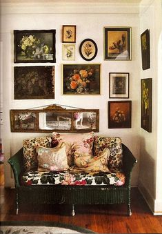 Tabard Inn floral oil paint still lifes, small Louis style sofa with wood frame.