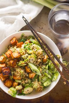 This hearty Brussels sprout fried rice has crispy fried rice and shaved Brussels sprouts with spicy chunks of baked sriracha marinated tofu.