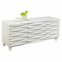 "Matte white sideboard with a wave design.   Product: SideboardConstruction Material: Solid wood and veneersColor: Matte white Features: Six drawers Dimensions: 25"" H x 59"" W x 20"" DNote: Assembly required"
