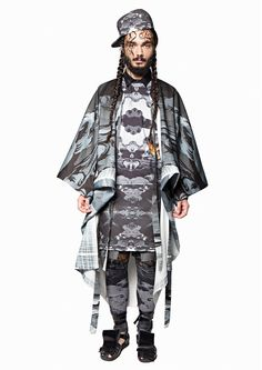 """SADAK's Spring/Summer 2014 """"in liminal space"""" collection, designed by Sasa Kovacevic embarks on a journey from Japan to Serbia. Mixing serbian hip hop subculture and japanese traditional dress, with a strong interest in serbian 19th century embroidery, japanese silk painting and serbian ethnography, the collection mixes a variety of colors, shapes, designs and prints. Color and silhouette exude a sporty elegance and pride in individuality."""