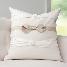 Jb9.90022  Take A Bow Pillow  Do Take a Bow! When texture is what is needed- this accent pillow is the ideal creature comfort. With detailed, neutral nuance the Take A Bow pillow is a lighthearted and feminine way to introduce style.