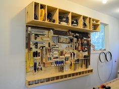 Diy slat wall storage system how to make a tool board for the shop. Wall Storage Systems, Tool Storage, Cabinet Storage, Storage Solutions, Garage Shelf, Garage Storage, Diy Bike, Wood Slat Wall, Tool Board