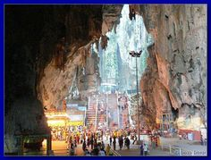 Batu Caves, Malaysia.   Temple Cave or Cathedral Cave is biggest of the caves and best known. The ceiling is 100 m above ground and this huge chamber is lighted by daylight from several holes in the ceiling. At the end of the caves you can see the bright sky, when you look above you. As the name suggests, this cave contains several shrines, and the Sir Sri Subramania Swamy Temple, visited by many devotees..