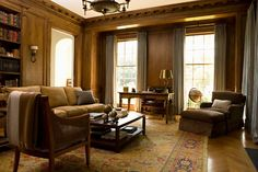 Elizabeth had hand-finished, walnut paneled walls put into the library to give it an Old World feel, and plush armchairs and a sofa make it a very functional space.