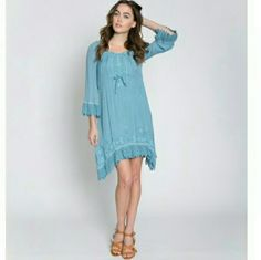 Embroidered Drawstring Dress Beautiful comfortable relaxed fit 3/4 sleeve blue hi-lo dress. Boho style embroidered dress with crochet trim. 65% rayon 35% polyester woven dress. *price firm*  (Please do not buy this listing, I will make one for you) Monoreno Dresses High Low