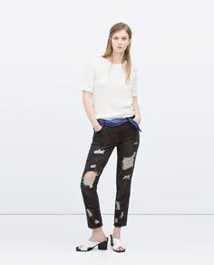 Image 1 of HIGH-RISE RIPPED SKINNY JEANS from Zara
