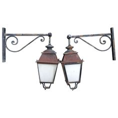 Large Scale Pair of French Lanterns on Brackets | From a unique collection of antique and modern lanterns at http://www.1stdibs.com/furniture/lighting/lanterns/