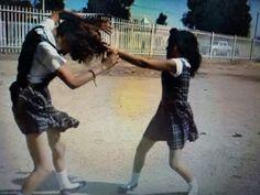 School girls in uniform battle nears end smaller girl in control