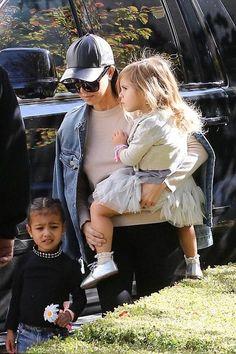 Kourtney Kardashian wearing Neil Barrett Hat, J Brand 421 Darci Jacket in Sinful, J Brand 620 Mid-Rise Super Skinny Jeans in Seriously Black and Inhabit Cashmere Crew Sweater in Tweed