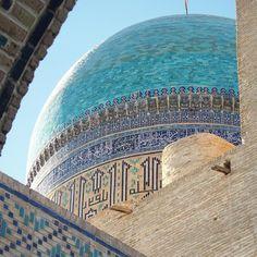 One of the domes peeking through the archways in Bukhara Uzbekistan. -- #Bukhara #Uzbekistan #dome #tile #calligraphy #Arabic #Persian #turquoise #brick #travel #learn #mosque #Islam #history #beautiful #architecture #Буxоро #узбекистон #Узбекистан