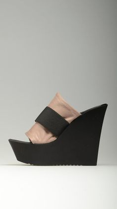 Dove grey leather uppers embellished wedges featuring elasticized band on the instep, grip-fast rubber sole, 5.2'' heel and 1.6'' plateau, 100% leather.