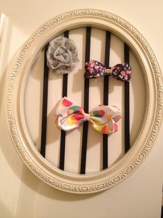 Made this for my sister! Followed these steps-    http://www.u-createcrafts.com/2009/06/funky-bow-holder-thingy-tutorial-from.html