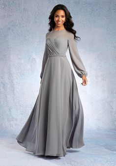 Braided Waist Detail Long Designer Bridesmaid Gown This full length bridesmaid dress moves gracefully with a layer of floor length chiffon and sheer bishop sleeves. The sweetheart surplice bodice and braided waist detail add structure. All 62 Dream in Color Shades