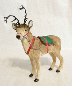 ANTIQUE PUTZ GERMAN MOHAIR REINDEER METAL ANTLERS AND GLASS EYES