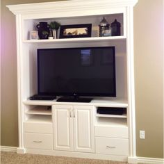 White built in entertainment center - I think i may have a closet this could replace...