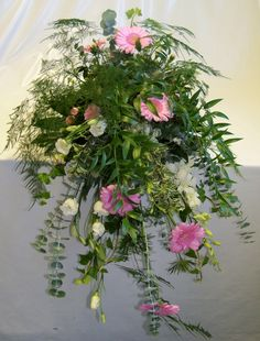 Waterfall style arrangement, flowers & foliages placed to show the movement, layering and flow. Wedding Arrangements, Floral Arrangements, Waterfall Design, British Flowers, Gerber Daisies, Floral Designs, Flower Arrangement, Contemporary Design, Layering