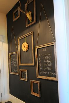 Chalkboard wall with reclaimed wood frames. So clever!