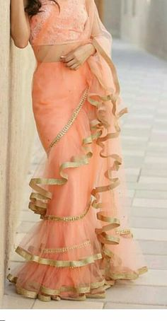 Latest Frill Ruffles Border Saree wedding readymade Blouse Indian net bride Sari Best Picture For Blouse collar For Your Taste You are looking for something, and it is going to tell you exactly what y Saree Gown, Sari Dress, Dhoti Saree, Indian Blouse, Indian Sarees, Indian Dresses, Indian Outfits, Latest Wedding Dresses Indian, Latest Designer Sarees