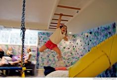 Slide, climbing wall, tunnels and monkey bars in the basement.  This house in Mountain View has a small backyard, so the parents built slides and secret ...
