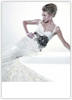 Love the lace detail on the top and straps of this wedding dress.