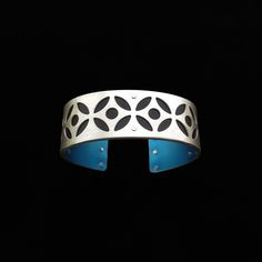 Handmade from sterling silver and anodized aluminum. #ilovegogojewelry #bullseye #cuff