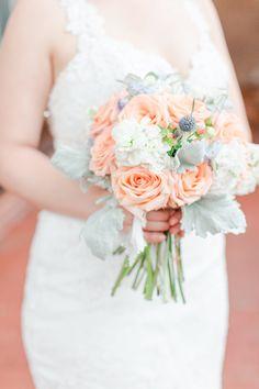 peach roses, blue thistle, dusty miller, peach hypericum berries, white stock summer bride's bouquet Dusty Miller, Wedding Flowers, Wedding Dresses, Bride Bouquets, Wedding Events, Floral Design, Peach, Table Decorations, Berries