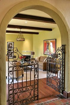 Wrought Iron Gate Indoors - Cool alternative to doors to open up the living space. Wrought Iron Decor, Wrought Iron Gates, Indoor Gates, Iron Work, Dog Rooms, Sweet Home, New Homes, House Design, Interior Design