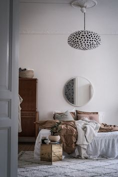 Brown and white bedroom in a Swedish home full of contrast / Bjurfors.