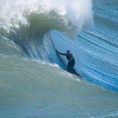 Garrett McNamara surfing the big waves of Nazaré North Canyon Portugal