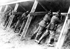 Germans in their well protected trenches on the Belgian frontier showing the men in the act of aiming at their enemy.